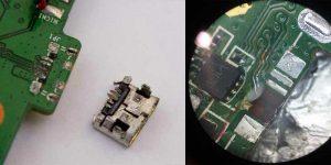 Вид поврежденных контактных площадок разъема зарядки на телефоне Lenovo и оторванного usb разъема